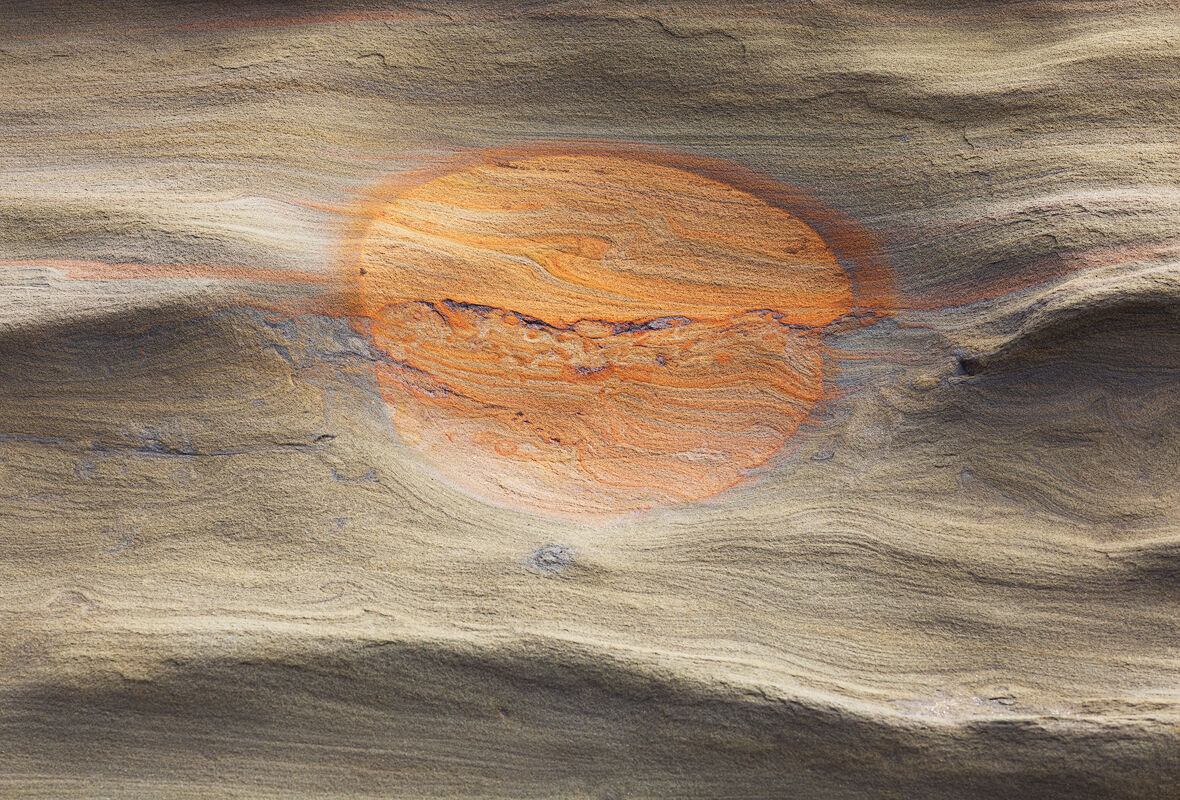 """Planetary design embedded in sandstone. If you look closely - it appears as though the """"eye"""" of Jupiter is at the top (rather..."""