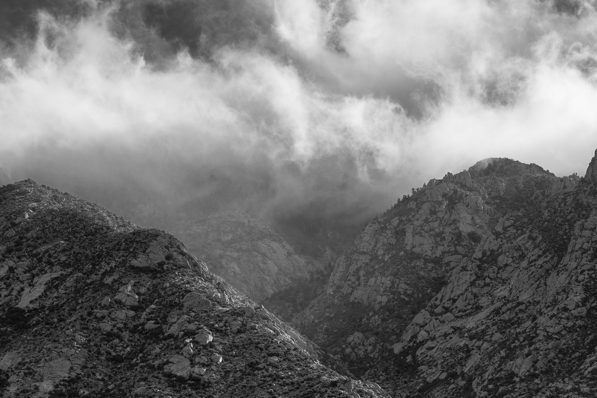 Low clouds dancing through the Sandia Mountains.