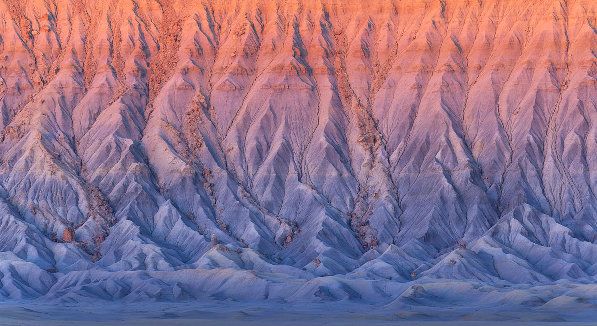 A summit that resembles fire at sunrise in Utah
